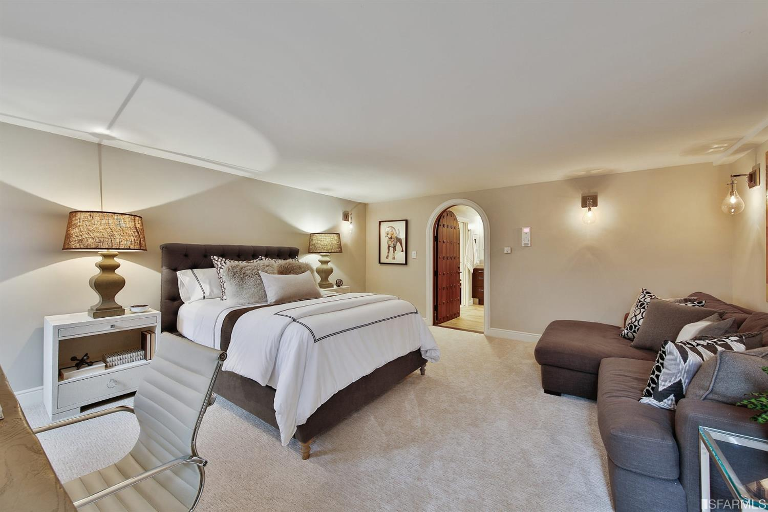 Bedroom 3 is also very large as it holds a large bed, sectional and desk.  The arched door opens to a beautiful en suite bath fo