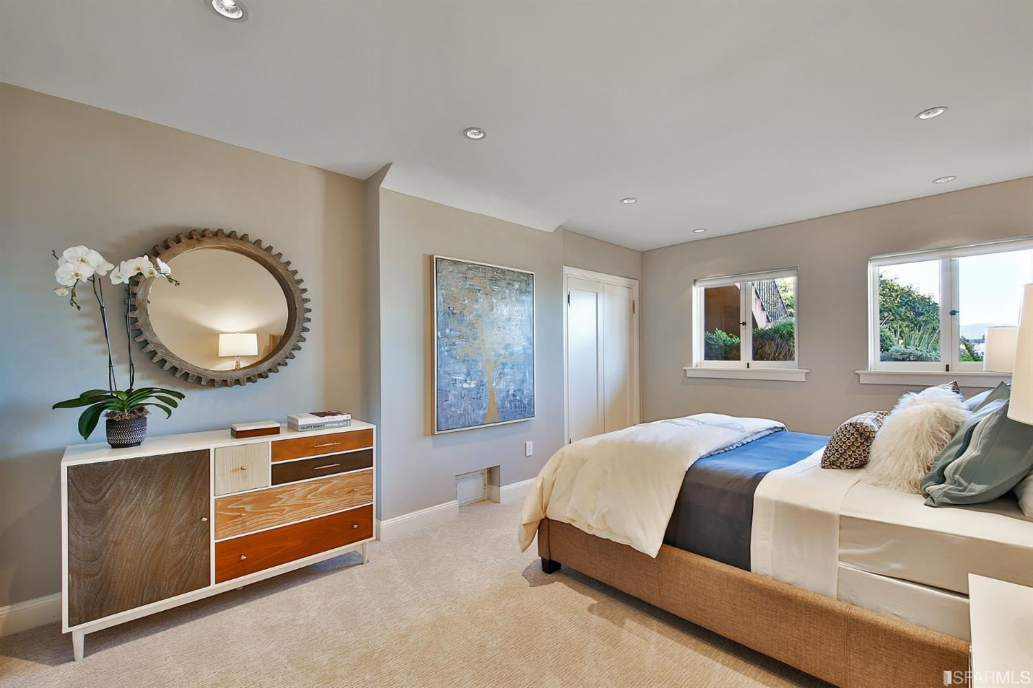 Bedroom #4 with 2 closets and gorgeous views of the landscaped garden & GGB.