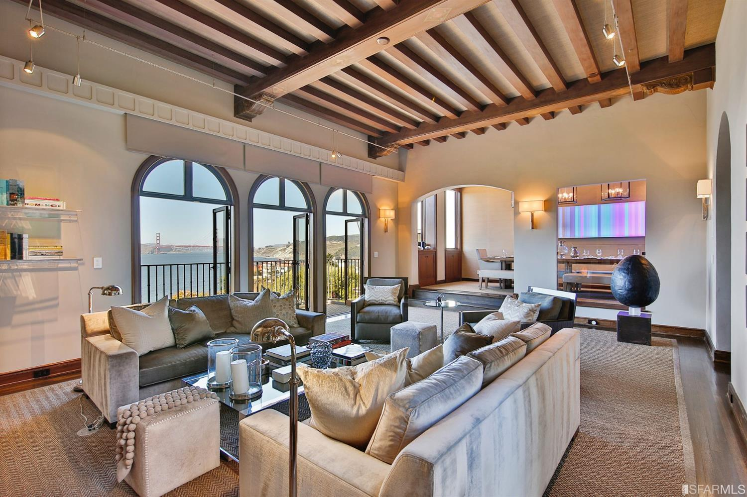 Grand formal living room - gracious in size with a modern aesthetic showcasing breathtaking views, high ceilings & architect