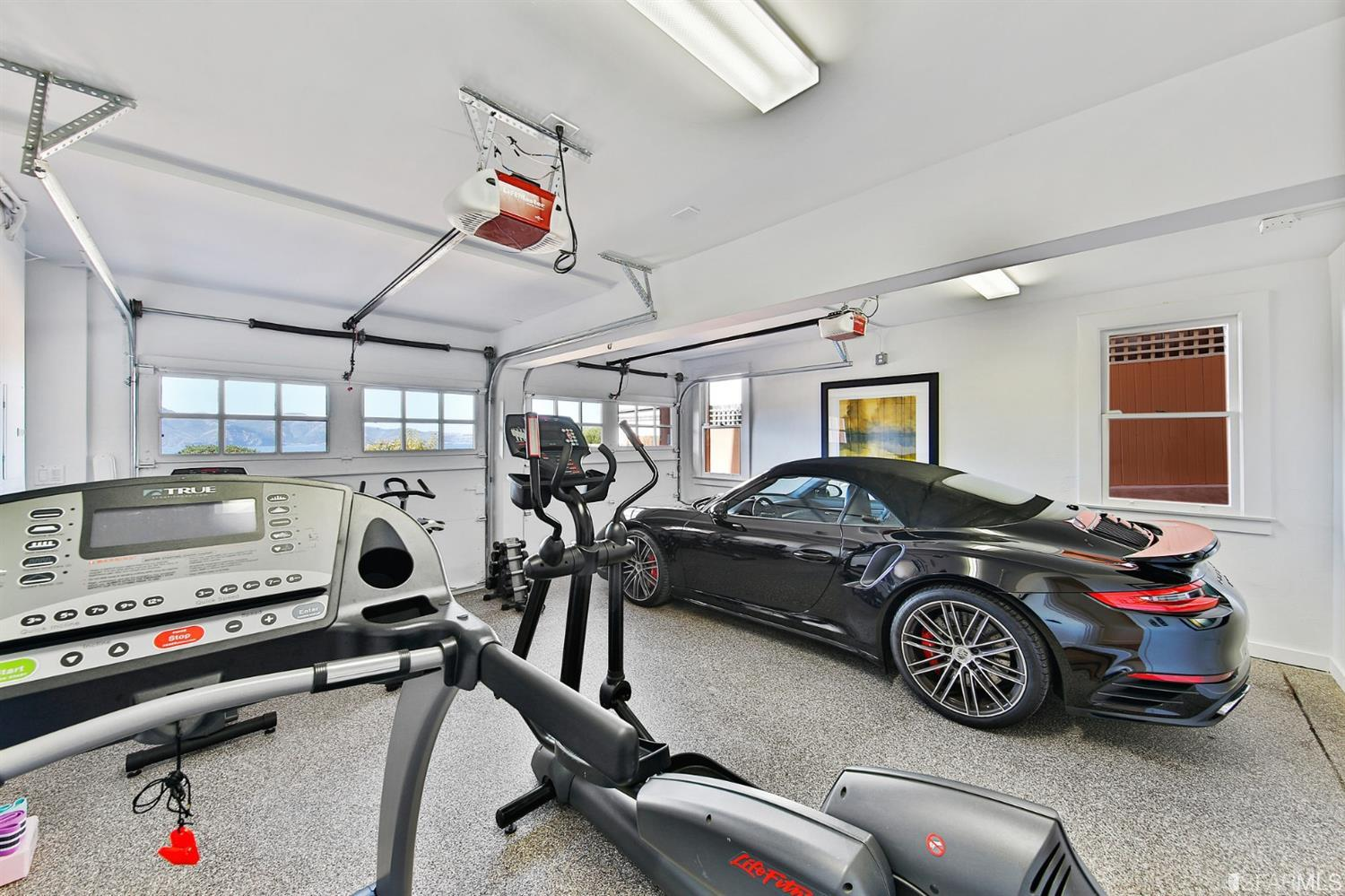 2-car garage.  1/2 of it has been turned into a home gym. It also has views.