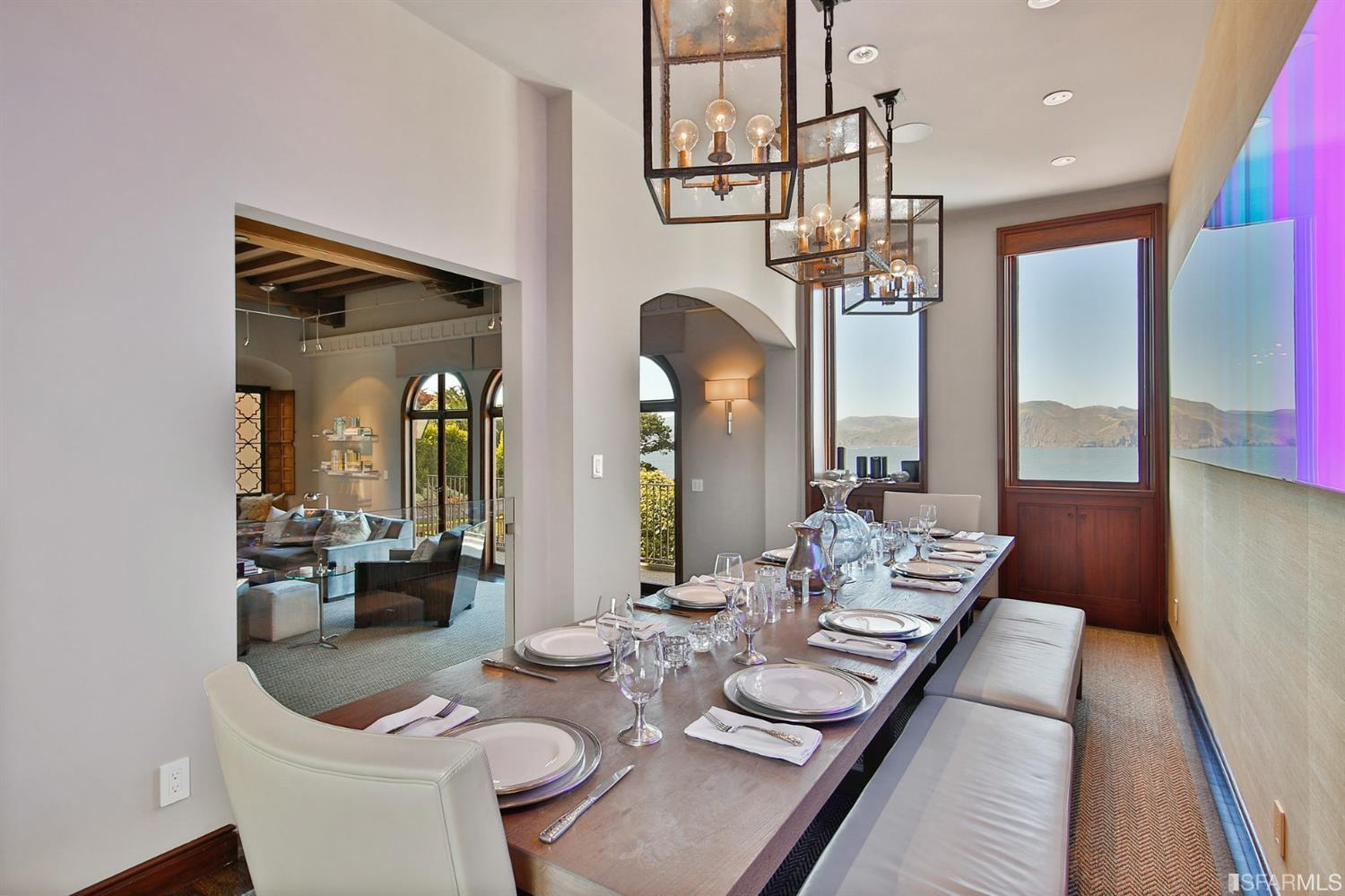 Also with sweeping views, this FDR is stylish, sophisticated and sexy.  I rarely say a dining room is sexy, but you'll have to e