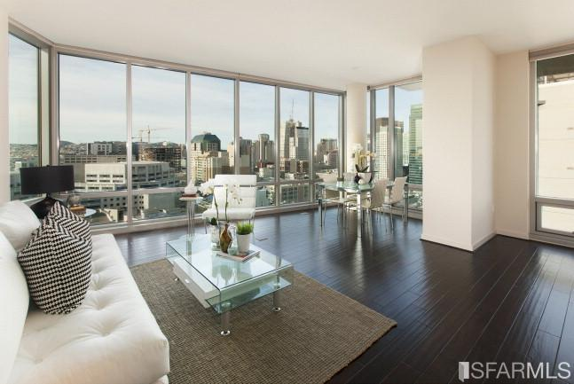 Residence 1707 is a corner residence with a large living/dining area with two floor to ceiling window walls...